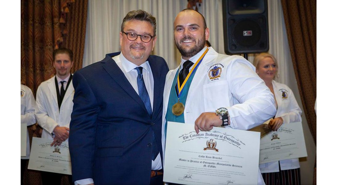 Rob Johnston, Principal of The Canadian Academy of Osteopathy, poses with Windsor's Colby Broeckel